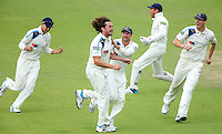 Picture by Alex Whitehead/SWpix.com - 12/09/2014 - Cricket - LV County Championship Div One - Nottinghamshire CCC v Yorkshire CCC, Day 4 - Trent Bridge, Nottingham, England - Yorkshire's Ryan Sidebottom (second left) celebrates with team-mates the wicket of Notts' Chris Read.