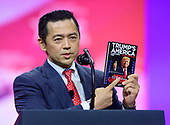 United States President Donald J. Trump holds up a book he translated into Japanese as he speaks at the Conservative Political Action Conference (CPAC) at the Gaylord National Resort and Convention Center in National Harbor, Maryland on Saturday, March 2, 2019.<br /> Credit: Ron Sachs / CNP