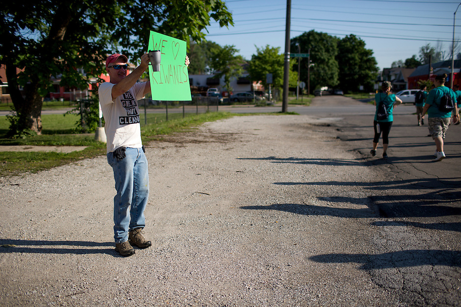 "A community leader pumps up members at the start of ""Circle the City with Service,"" the Kiwanis Circle K International's 2015 Large Scale Service Project, on Wednesday, June 24, 2015, in Indianapolis. (Photo by James Brosher)"