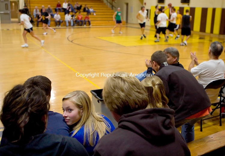 THOMASTON, CT- 29 DECEMBER 2008 --122908JS02-Lizzie Mendola, left, a senior and co-captian on the Thomaston High School girls basketball team, talks with friends during the Thomaston High School alumni basketball game held Monday at Thomaston High School. Money raised from the event will go to the general fund for the Class of 2009 and the Daniel Abbott Memorial Scholarship Fund. <br /> Jim Shannon / Republican-American