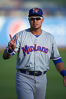 Midland RockHounds designated hitter Renato Nunez (34) during warmups before a game against the Tulsa Drillers on June 2, 2015 at Oneok Field in Tulsa, Oklahoma.  Midland defeated Tulsa 6-5.  (Mike Janes/Four Seam Images)