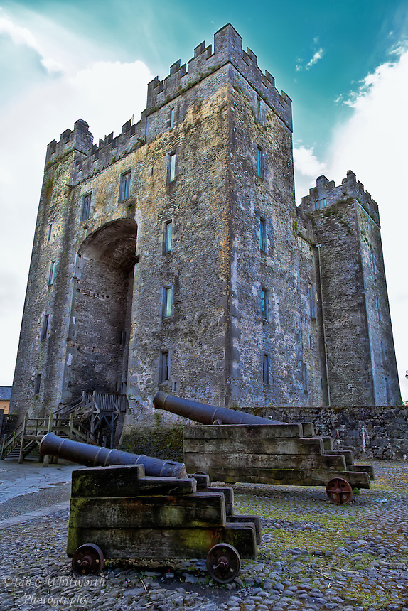 Looking up past the cannon at Bunratty Castle in Ireland.