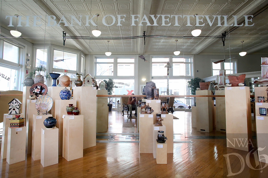 NWA Democrat-Gazette/DAVID GOTTSCHALK Handcrafted pottery created by members of the Boston Mountain Potters Association is on display Wednesday, January 9, 2019, at the Bank of Fayetteville on the square in Fayetteville. The pottery, all available for purchase, will be up through the month of January.