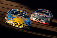 Nov 13, 2005; Phoenix, Ariz, USA;  Nascar Nextel Cup driver Jeff Green driver of the #43 Cheerios Dodge leads Sterlin Marlin during the Checker Auto Parts 500 at Phoenix International Raceway. Mandatory Credit: Photo By Mark J. Rebilas