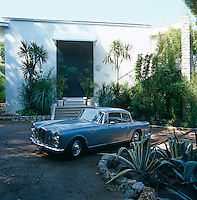 A 1960 Graber Alvis car stands in the driveway of the house that was built in 1969