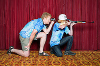 James McCollum (cq, age 15) with his dad and coach Kevin McCollum (cq) with the Harrisburg Hunters and Anglers BB Rifleman at the 2014 Daisy National BB Gun Championship Match in Rogers, Arkansas, Friday, July 4, 2014.<br /> <br /> Photo by Matt Nager