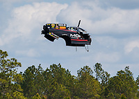 Mar 18, 2018; Gainesville, FL, USA; The carbon fiber Dodge body from the funny car of NHRA driver Matt Hagan flies through the air after an engine explosion during the Gatornationals at Gainesville Raceway. Mandatory Credit: Mark J. Rebilas-USA TODAY Sports