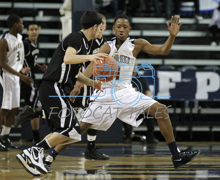 Agassi Prep's Demetrius White defends against West Wendover's Avery Arrien during the NIAA 2A State Basketball Championship game between West Wendover and Agassi Prep high schools at Lawlor Events Center, in Reno, Nev, on Saturday, Feb. 25, 2012. West Wendover won 69-68..Photo by Cathleen Allison