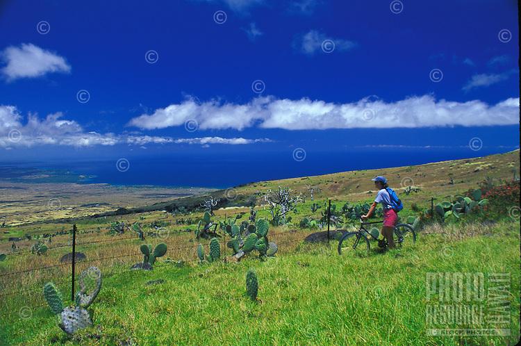 Biking high above the coastline on the Big Island of Hawaii