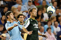 Milos Stojcev (88)  midfielder Sporting KC and Jack Jewsbury (13) midfielder Portland Timbers keep their eyes on the ball... Sporting Kansas City defeated Portland Timbers 3-1 at LIVESTRONG Sporting Park, Kansas City, Kansas.