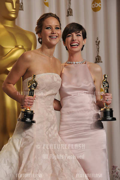 Jennifer Lawrence & Anne Hathaway at the 85th Academy Awards at the Dolby Theatre, Los Angeles..February 24, 2013  Los Angeles, CA.Picture: Paul Smith / Featureflash