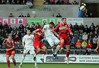 ATTENTION SPORTS PICTURE DESK<br /> Pictured: Ashley Williams of Swansea (C in white) heads the ball over the bar from a cross while Matthew Bates of Middlesbrough battles against him (R)<br /> Re: npower Championship, Swansea City FC v Middlesbrough Football Club at the Liberty Stadium, south Wales. Sunday 14 November 2010