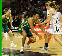 Opals guard Eva Afeaki and Ferns guard Toni Edmondson compete for the ball during the International women's basketball match between NZ Tall Ferns and Australian Opals at Te Rauparaha Stadium, Porirua, Wellington, New Zealand on Monday 31 August 2009. Photo: Dave Lintott / lintottphoto.co.nz