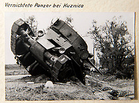 BNPS.co.uk (01202 558833)<br /> Pic: Dickins/BNPS<br /> <br /> Operation Barbarossa - 'Destroyed tank near Kuznico'<br /> <br /> The unseen personal photo album of Field Marshal Wolfram von Richthofen, cousin to the legendary Red Baron, which gives an unprecedented insight into his military career in the Third Reich, has been rediscovered.<br /> <br /> Wolfram served in the Red Baron's squadron in the WW1, went on to design the 'Jericho trumpet' of the infamous Stuka Bomber between the wars, before leading the Condor Legion in the Spanish Civil War.<br /> <br /> After the outbreak of WW2 the fascinating album shows Richthofen's lead roll in Operation Barbarossa - the Nazi's suprise invasion of Communist Russia and their race to conquer the vast country before the onset of the notorious Russian winter.<br /> <br /> The two albums were taken from Berlin by a British soldier at the end of the Second World War who kept it for 60 years before it was passed into the hands of a private collector.<br /> <br /> Dickins auctions are selling the historic albums with a &pound;20,000 estimate on 31st March.