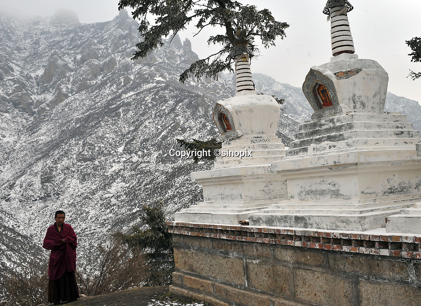 A monk looks over the mountains at an outpost of the Youning Temple near Xining, Qinghai Province 13 November 2008. Qinghai Province in western China borders Tibet and parts were the scenes of disturbance earlier this year, 2008.<br /> <br /> Photo by Richard Jones
