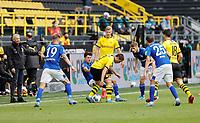 16th May 2020, Signal Iduna Park, Dortmund, Germany; Bundesliga football, Borussia Dortmund versus FC Schalke;  Coach Lucien Favre watches as Alessandro Schöpf and BVB Raphal Guerreiro  compete for the ball