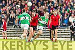 Kieran Dineen Na Gaeil in action against Jack Brosnan Glenbeigh Glencar in the Castleisland Mart Junior Premier Football Championship.