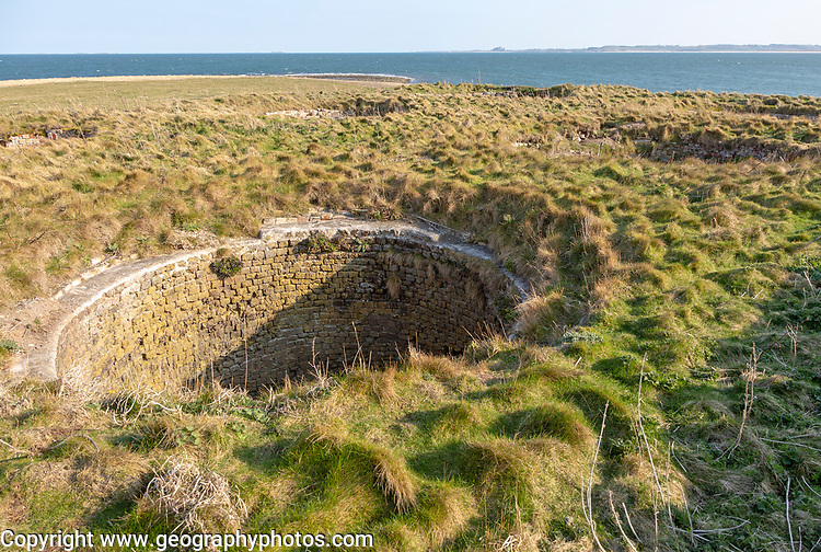 Top of old lime kilns on Holy Island, Northumberland, England, UK view south of coastline