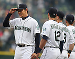 Seattle Mariners' pitcher Iwakuma Hisashi, of Japan, touches his hat after being introduced before their game against theLos Angeles Angels in the  season home opener April 6, 2015 at Safeco Field in Seattle.  The Mariners beat the Angels 4-1.       ©2015. Jim Bryant Photo. ALL RIGHTS RESERVED.