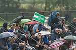 13.05.2018, SV Victoria Gersten e.V., Gersten, GER, FSP, Samtgemeideauswahl Lengerich vs SV Werder Bremen<br /> <br /> im Bild<br /> Wetterfeature, Fans auf Trib&uuml;ne mit Fahne, Regenschrimen, <br /> <br /> Foto &copy; nordphoto / Ewert