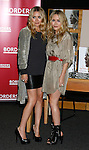 "WESTWOOD, CA. - November 12: Ashley Olsen and Mary Kate Olsen pose at the signing of their book ""Influence"" at Borders Bookstore on November 12, 2008 in Westwood, California."