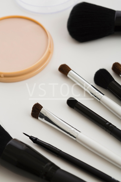 Make-up brushes in a row on table