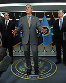 United States President George W. Bush speaks to the media after visiting the Office of the Director of National Intelligence and the National Counterterrorism Center (NCTC) in McLean, Virginia, on December 8, 2008. With Bush is NTCT Director Mike Leiter (L) and  Director of National Intelligence Mike McConnell (R).<br /> Credit: Roger L. Wollenberg / Pool via CNP