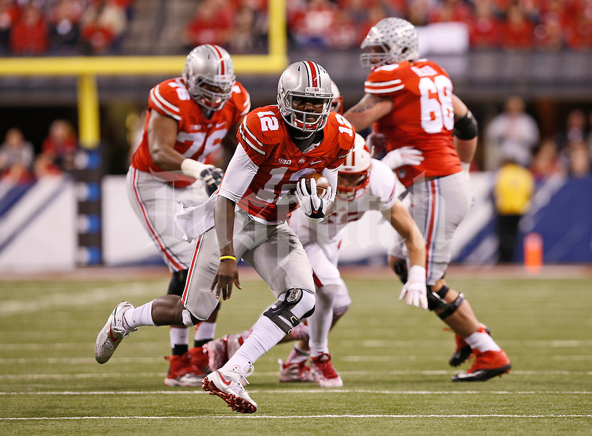 Ohio State Buckeyes quarterback Cardale Jones (12) runs upfield during the second quarter of the Big Ten Championship game against the Wisconsin Badgers at Lucas Oil Stadium in Indianapolis on Dec. 6, 2014. (Adam Cairns / The Columbus Dispatch)