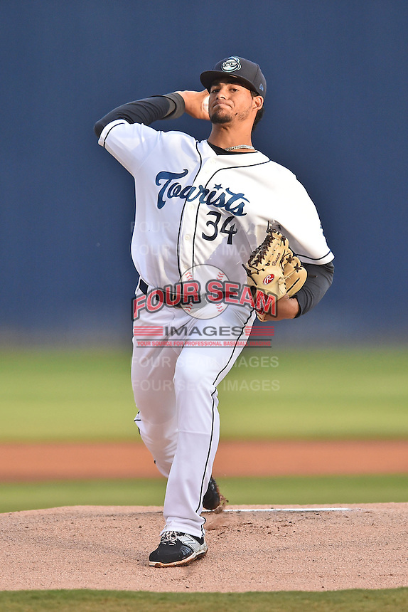 Asheville Tourists starting pitcher Jesus Tinoco (34) warms up before game one of the Southern Division South Atlantic League Playoffs against the Savannah Sand Gnats on September 9, 2015 in Asheville, North Carolina. The Tourists defeated the Sand Gnats 5-1. (Tony Farlow/Four Seam Images)