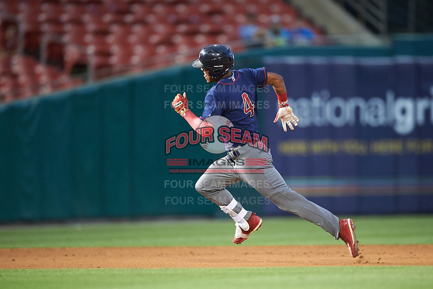 Lehigh Valley IronPigs left fielder Nick Williams (4) runs to third after hitting a triple during a game against the Buffalo Bisons on July 9, 2016 at Coca-Cola Field in Buffalo, New York.  Lehigh Valley defeated Buffalo 9-1 in a rain shortened game.  (Mike Janes/Four Seam Images)