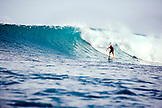 INDONESIA, Mentawai Islands, Kandui Resort, a man surfing a wave, Bankvaults