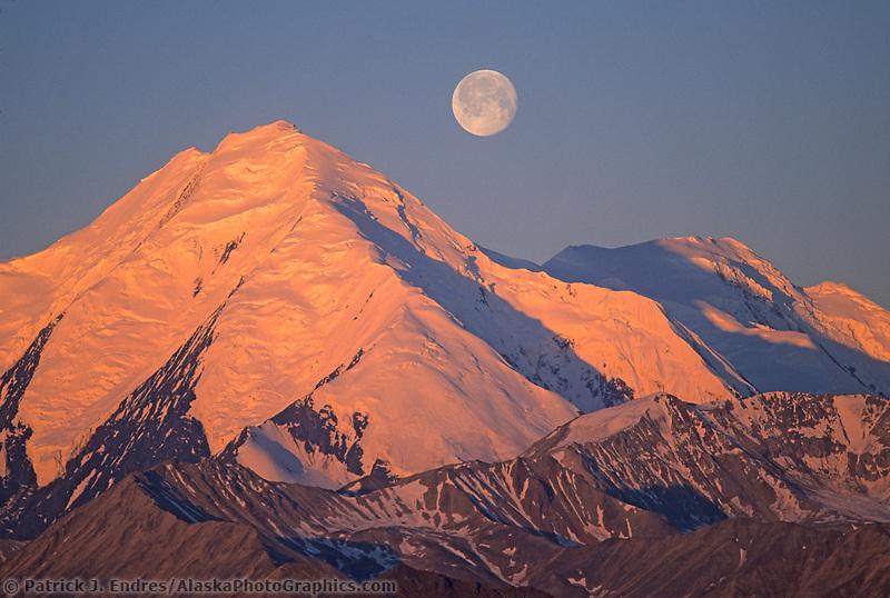 Full moon sets over the Alaska mountain range, Denali National Park, Alaska