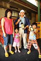 CEO Yoshinobu Sugiura with his family, Sugiura Mirin, Hekinan, Aichi pref, Japan, August 28, 2010.