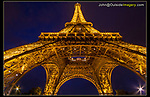 France, Paris.  <br /> Why not experiment and try a different vantage points? Sometime switching lenses and referring to a Shot List can help stir your creativity.  Under the Eiffel Tower at night.