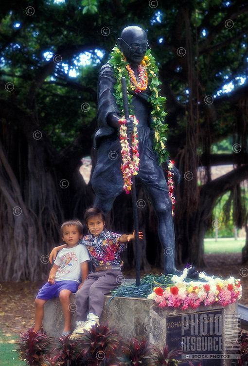 Kids with the Mohandas Gandhi statue in Waikiki, located near the Honolulu zoo.