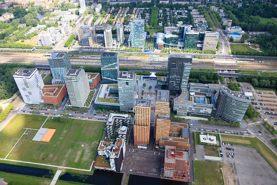 Nederland, Noord-Holland, Amsterdam, 14-06-2012; ZIcht op de Zuidas met ring A10,  Prinses Irenebuurt in de achtergrond..View on financial district of Amsterdam. The A10 ringroad runs between the high-rise offices.  .luchtfoto (toeslag), aerial photo (additional fee required).foto/photo Siebe Swart