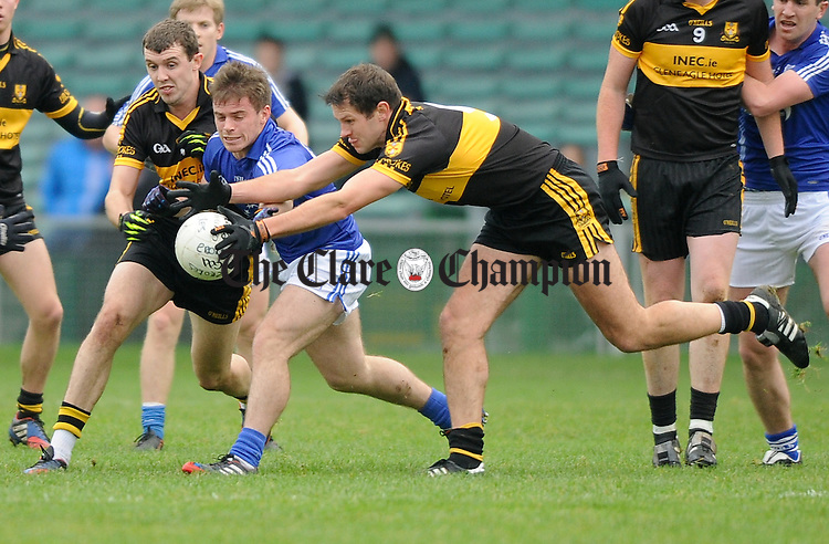 Sean Collins of Cratloe in action against Michael Moloney and Eoin Brosnan of Dr. Crokes during their Munster club football final at The Gaelic Grounds. Photograph by John Kelly.