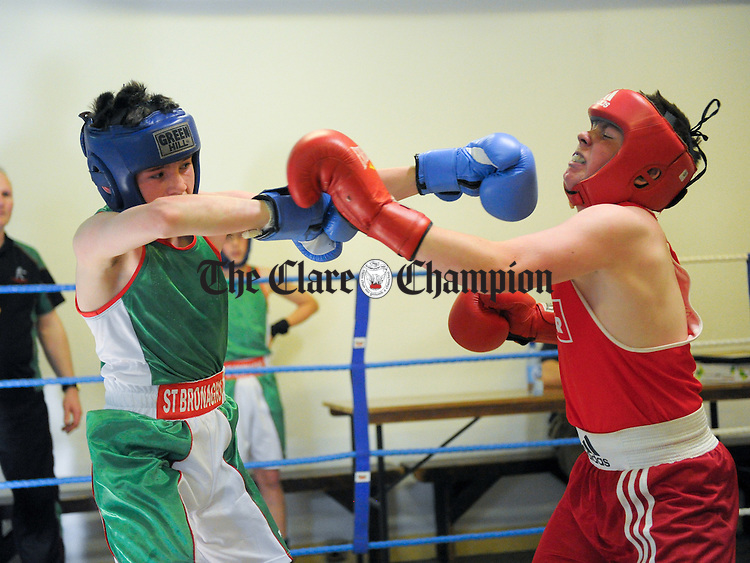 Matt Murnioun of St Bronagh's in action against Jamie Keane of Ennis during the boxing event in Ennis Boxing Club as  part of the Newry And Mourne District Council Twinning Sports Exchange Weekend. Photograph by John Kelly.
