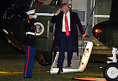 United States President Donald Trump salutes a US Marine as he disembarks from Marine One on his return to the White House from a long weekend at his Mar-a-Lago estate in Florida, on President's Day, February 20, 2017, Washington, DC.       <br /> Credit: Mike Theiler / Pool via CNP