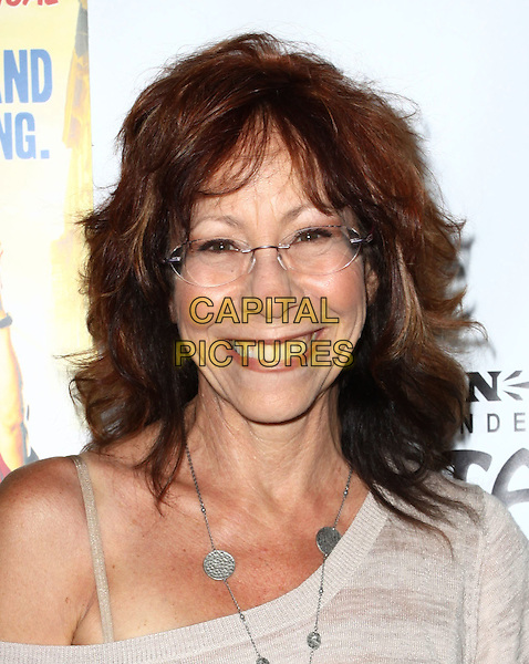 "MINDY STERLING.Broadway Musical Los Angeles premiere Of  ""In the Heights"" held at The Pantages Theatre, Hollywood, CA, USA..June 23rd, 2010.headshot portrait white grey gray off the shoulder silver necklace glasses smiling .CAP/ADM/KB.©Kevan Brooks/AdMedia/Capital Pictures."