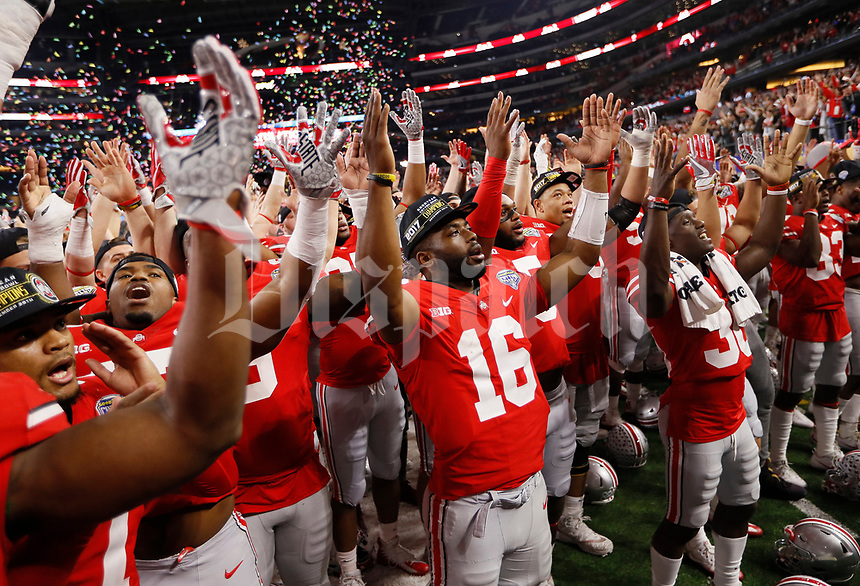 Ohio State Buckeyes quarterback J.T. Barrett (16) and teammates sing Carmen Ohio following their 24-7 win over the USC Trojans in the Goodyear Cotton Bowl Classic at AT&T Stadium in Arlington, Texas on Dec. 29, 2017. [Adam Cairns / Dispatch]