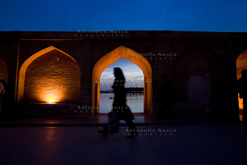 A woman walks at the Si-o-Seh Pol bridge (Bridge of 33 Arches) in Isfahan.
