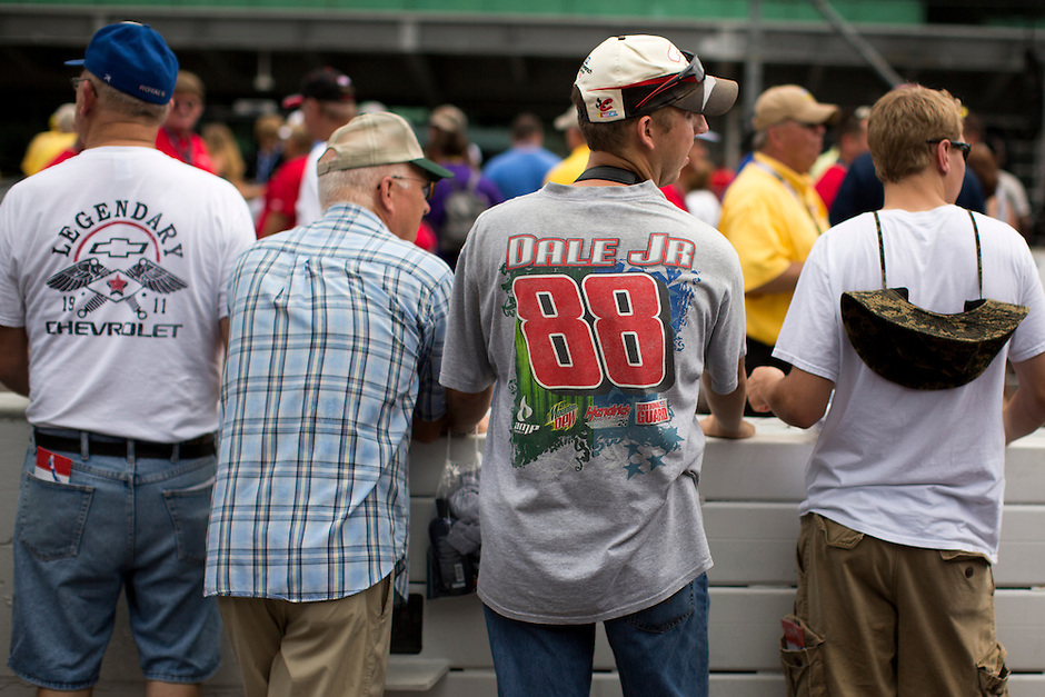 Fans stand along pit road before the Brickyard 400 on Sunday, July 26, 2015, at the Indianapolis Motor Speedway. (Photo by James Brosher)