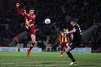 Matthew Lund of Bradford City passes away from Samy Morsy of Wigan during the Sky Bet League 1 match between Bradford City and Wigan Athletic at the Northern Commercial Stadium, Bradford, England on 14 March 2018. Photo by Thomas Gadd.
