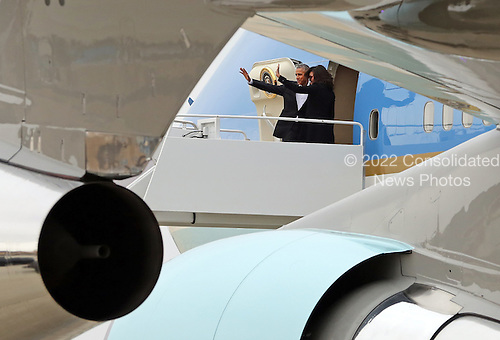 United States President Barack Obama and first lady Michelle Obama wave goodbye as they board Air Force One at Joint Base Andrews near Washington, D.C. on their way to Cuba, March 20, 2016.<br /> Credit: Martin H. Simon / Pool via CNP