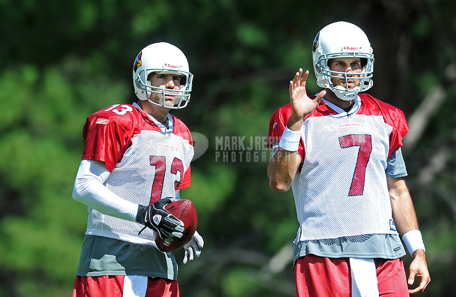 Jul 31, 2009; Flagstaff, AZ, USA; Arizona Cardinals quarterbacks (13) Kurt Warner and (7) Matt Leinart during training camp on the campus of Northern Arizona University. Mandatory Credit: Mark J. Rebilas-
