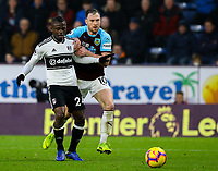Fulham's Jean Michael Seri holds off the challenge from Burnley's Ashley Barnes<br /> <br /> Photographer Alex Dodd/CameraSport<br /> <br /> The Premier League - Burnley v Fulham - Saturday 12th January 2019 - Turf Moor - Burnley<br /> <br /> World Copyright © 2019 CameraSport. All rights reserved. 43 Linden Ave. Countesthorpe. Leicester. England. LE8 5PG - Tel: +44 (0) 116 277 4147 - admin@camerasport.com - www.camerasport.com