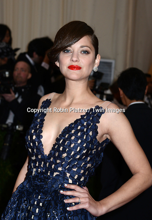 Marion Cotillard attends the Costume Institute Benefit on May 5, 2014 at the Metropolitan Museum of Art in New York City, NY, USA. The gala celebrated the opening of Charles James: Beyond Fashion and the new Anna Wintour Costume Center.