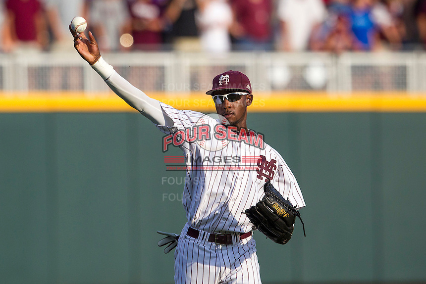 Mississippi State outfielder Demarcus Henderson (2) warms up prior to Game 1 of the 2013 Men's College World Series Finals against the UCLA Bruins on June 24, 2013 at TD Ameritrade Park in Omaha, Nebraska. The Bruins defeated the Bulldogs 3-1, taking a 1-0 lead in the best of 3 series. (Andrew Woolley/Four Seam Images)