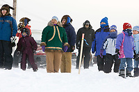 Kaltag residents await the arrival of the 1st musher into their village during 2006 Iditarod Western AK